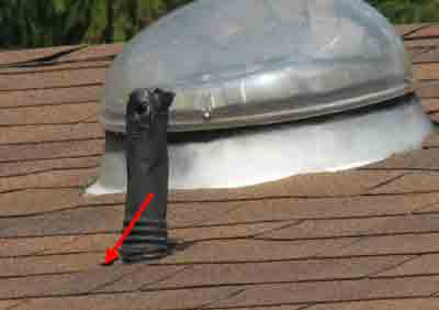vent pipe flashing is tucked under the shingles below the vent pipe