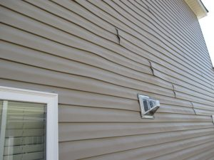 warped vinyl siding on Woodinville home